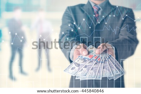 Businessman with money in hand, US dollar (USD) bills - investment, success and profitable business concepts.Forex graph on the background. A metaphor of international financial consulting - stock photo
