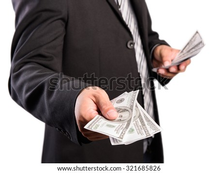 Businessman with money in hand, US dollar (USD) bills on white background - stock photo