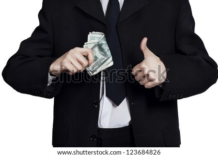 Businessman with money showing hand ok sign - stock photo