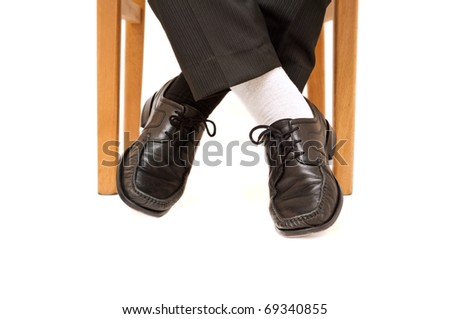 Businessman with non matching socks - stock photo