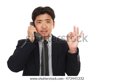 Businessman with ok hand sign