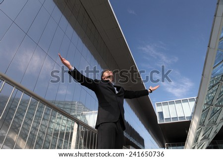 businessman with open arms to the sky - stock photo