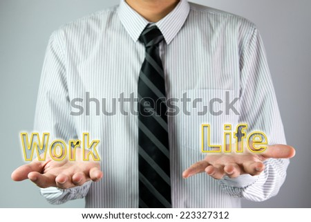 Businessman with open hands palm balancing the word work and life - stock photo