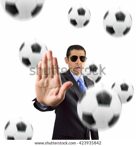 businessman with open palm gesturing to stop ball of football soccer on white background - stock photo