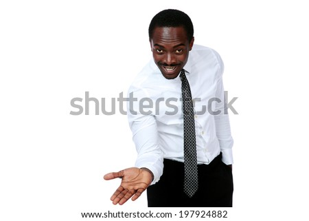 Businessman with open palm offering something over white background - stock photo