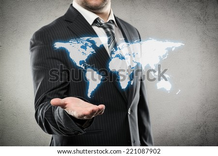 Businessman with open palm showing world map. Concept of worldwide trade and ecommerce.  - stock photo