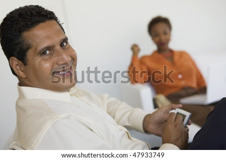 Businessman With PDA - stock photo