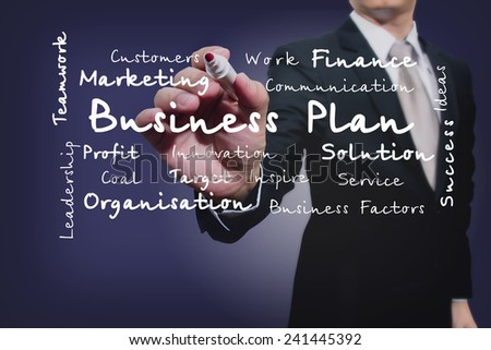 businessman with pen writing on the screen.Business Factors  - stock photo