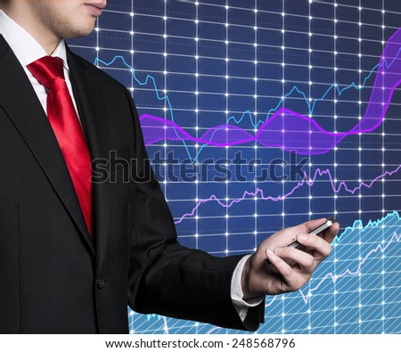 businessman with phone and stock chart on virtual screen - stock photo