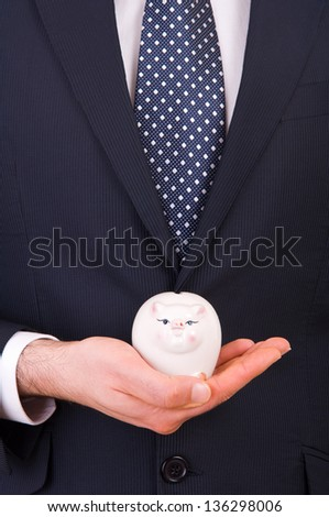 Businessman with piggy bank. - stock photo