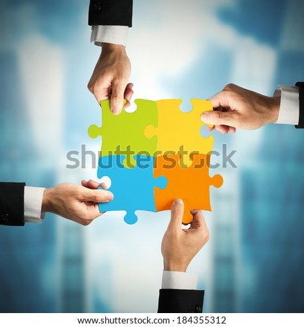 Businessman with puzzle. Concept of teamwork and partnership concept - stock photo