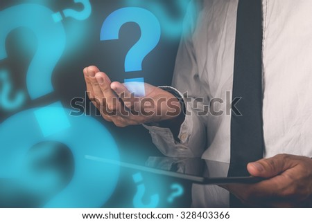 Businessman with questions, businessperson with digital tablet holding question mark, retro toned image, selective focus - stock photo