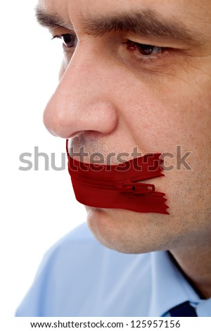 Businessman with red flies on his mouth concept of keeping secret