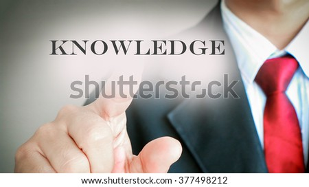 """Businessman with red tie showing press on text """"KNOWLEDGE"""", Success business concept. - stock photo"""