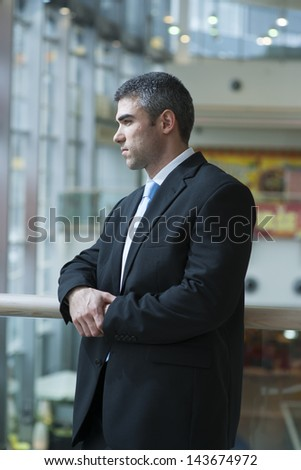 Businessman with serious expression looking off camera - stock photo