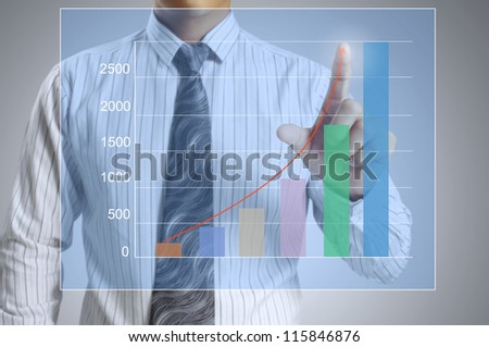 Businessman with show a graph - stock photo