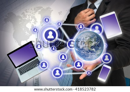 Businessman with show hand posture with the Social media and technology device on blurred building background, Elements of this image furnished by NASA, Business network concept - stock photo