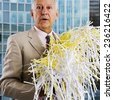 Businessman with Shredded Paper - stock photo