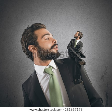 Businessman with small himself in the shoulder