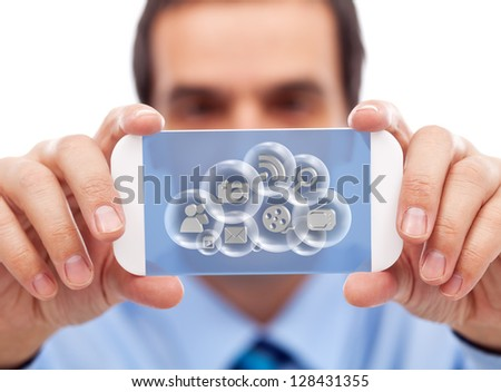 Businessman with smartphone or modern gadget accessing cloud computing applications