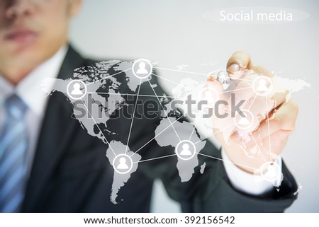Businessman with Social Media and map   - stock photo