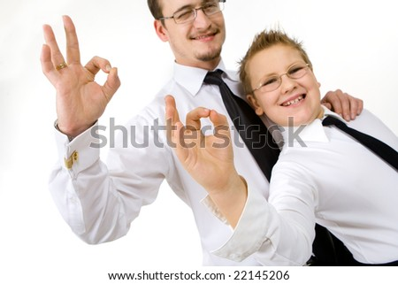 "Businessman with son making ""ok"" signs with fingers"
