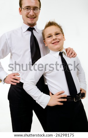 Businessman with son neatly dressed. Smiling