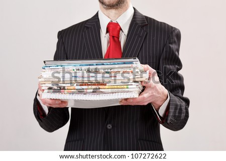 businessman with stack of paper - stock photo