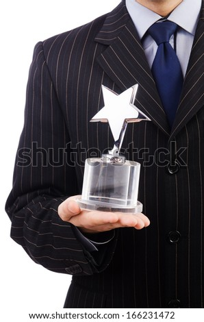 Businessman with star award isolated on white - stock photo