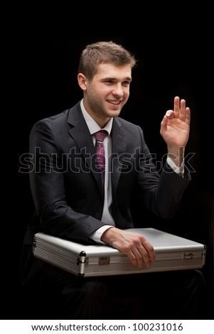 businessman with steel case over black