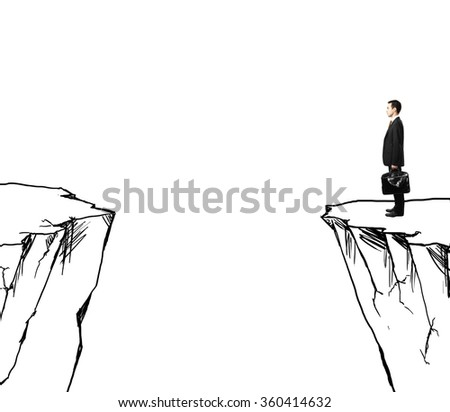 businessman with suitcase looking at drawing rock - stock photo