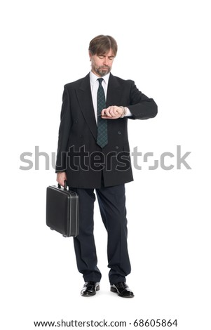 Businessman with suitcase looking at your watch. - stock photo