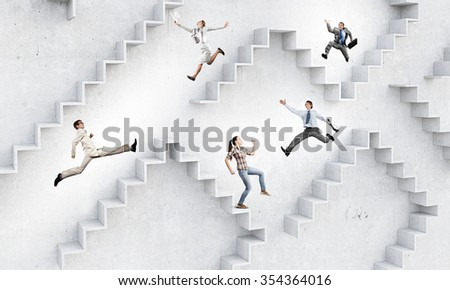 Businessman with suitcase running on stone staircase
