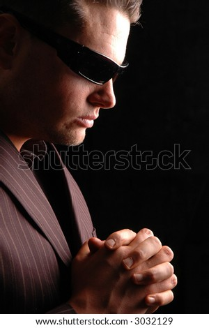 businessman with sunglasses praying with hope