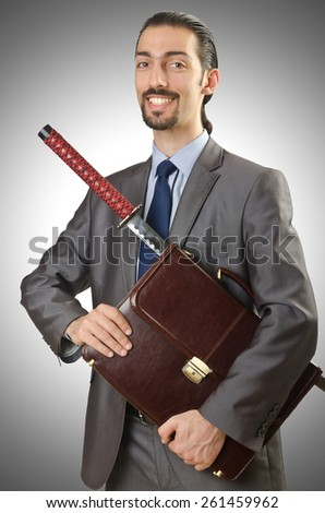 Businessman with sword on white - stock photo
