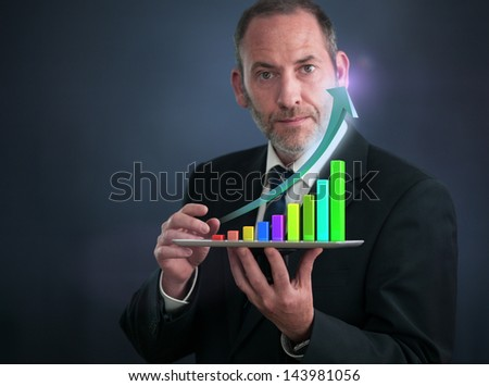 Businessman with Tablet Pc shows an analysis tool graph - stock photo