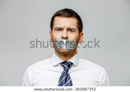 businessman with tape sealed mouth