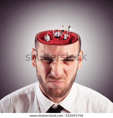 Businessman with the brain as a labyrinth - stock photo