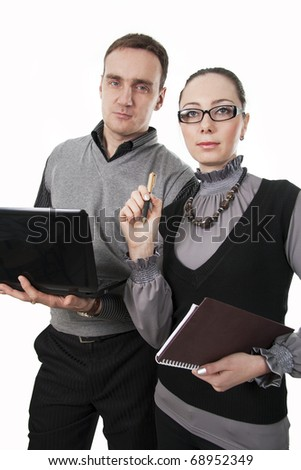 Businessman with the computer and businesswoman at a meeting. - stock photo