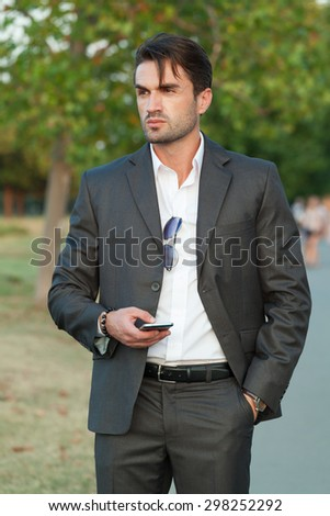 businessman with the smartphone on the street - stock photo