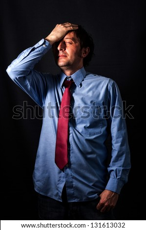 Businessman with the stress in low key technique - stock photo