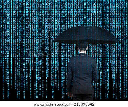Businessman with the umbrella standing in front of Matrix background - stock photo