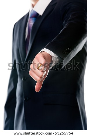Businessman with thumb down - stock photo