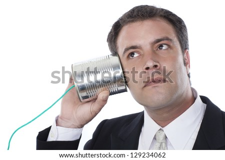 businessman with tin can phone over white - stock photo