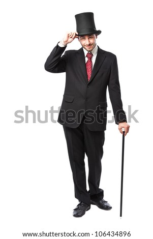 Businessman with Top Hat and walking stick in a suite - stock photo