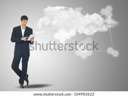 Businessman with touch screen Internet Tablet and the cloud computing concept and business network - stock photo