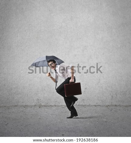 businessman with umbrella - stock photo