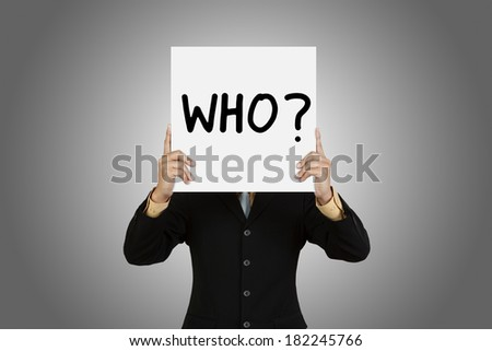 Businessman with word Who on gray background