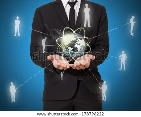 businessman with world of business in hand