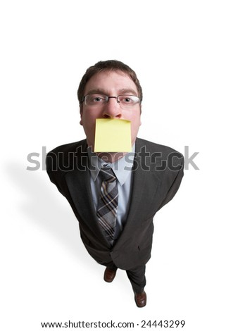 Businessman with yellow sticky note over mouth - stock photo